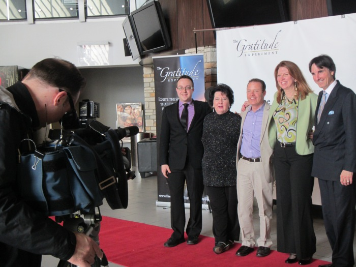 Members from the cast of The Gratitude Experiment being interviewed in the media